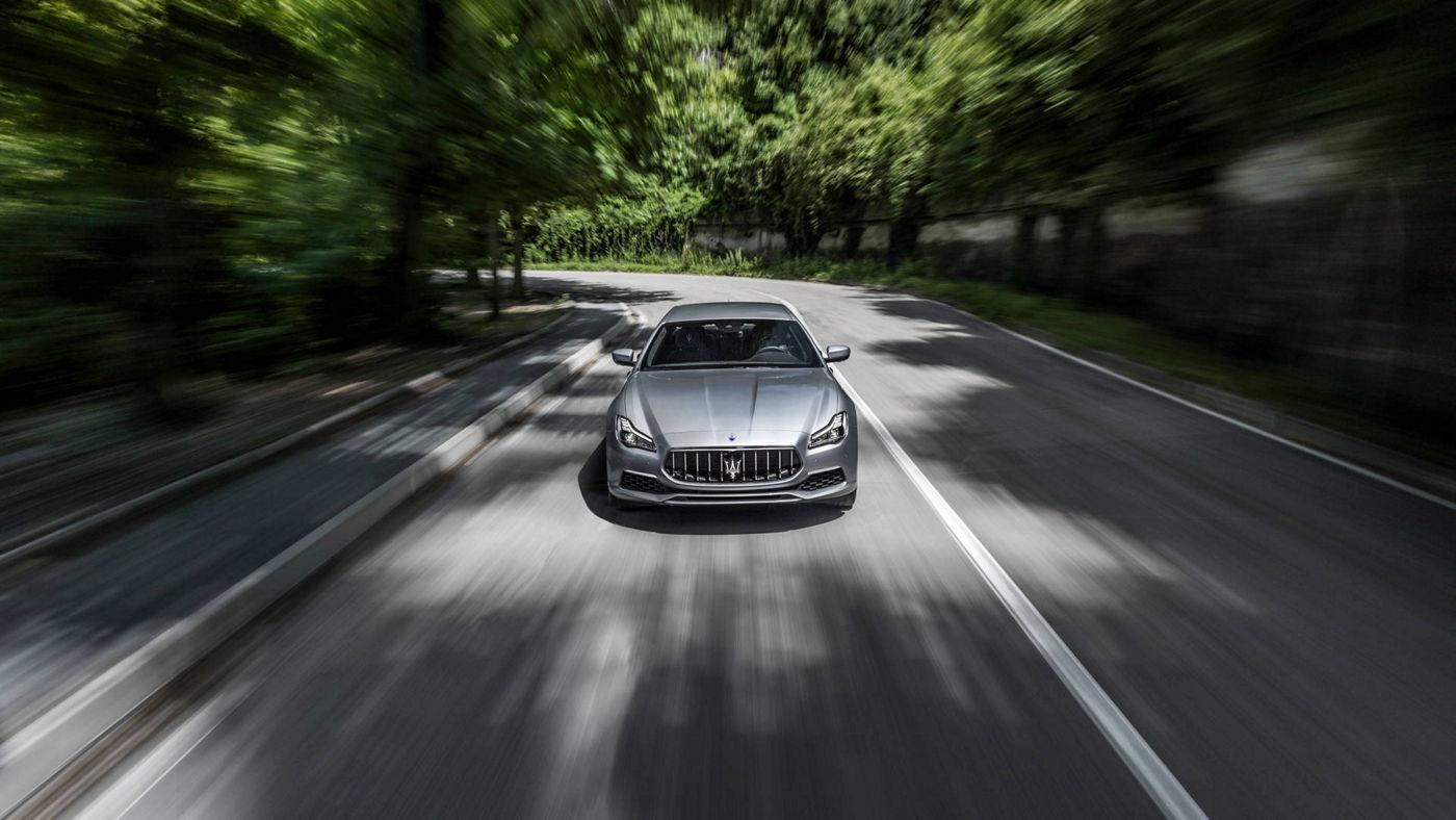 On the road Maserati Quattroporte GranLusso - grey, front view