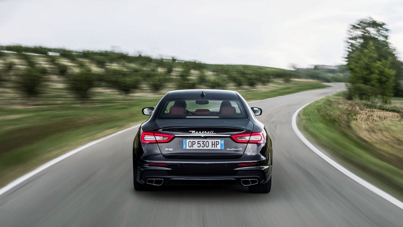 Rear view of a black Maserati Quattroporte driving in countryside - Limited-Slip Differential technology