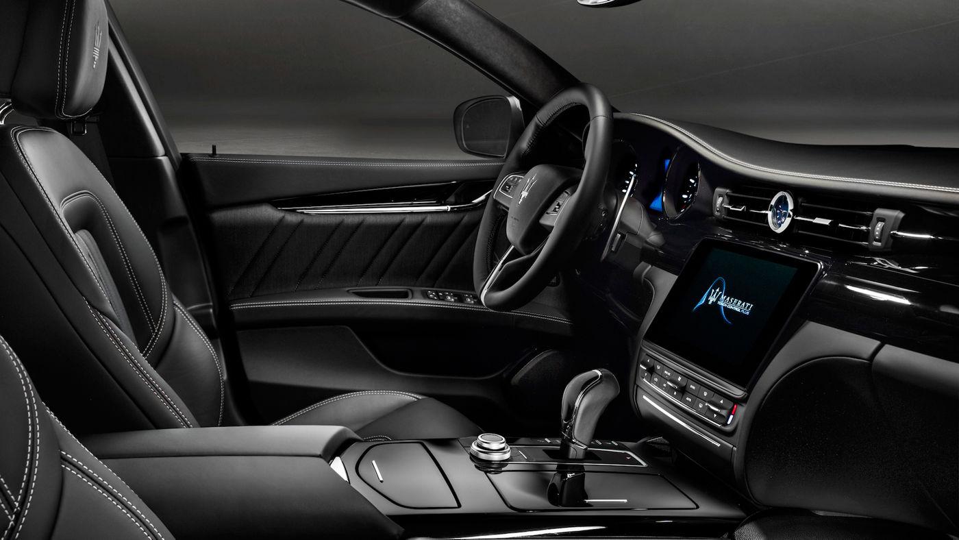 Maserati Quattroporte performance car - dashboard and interior black leather design details