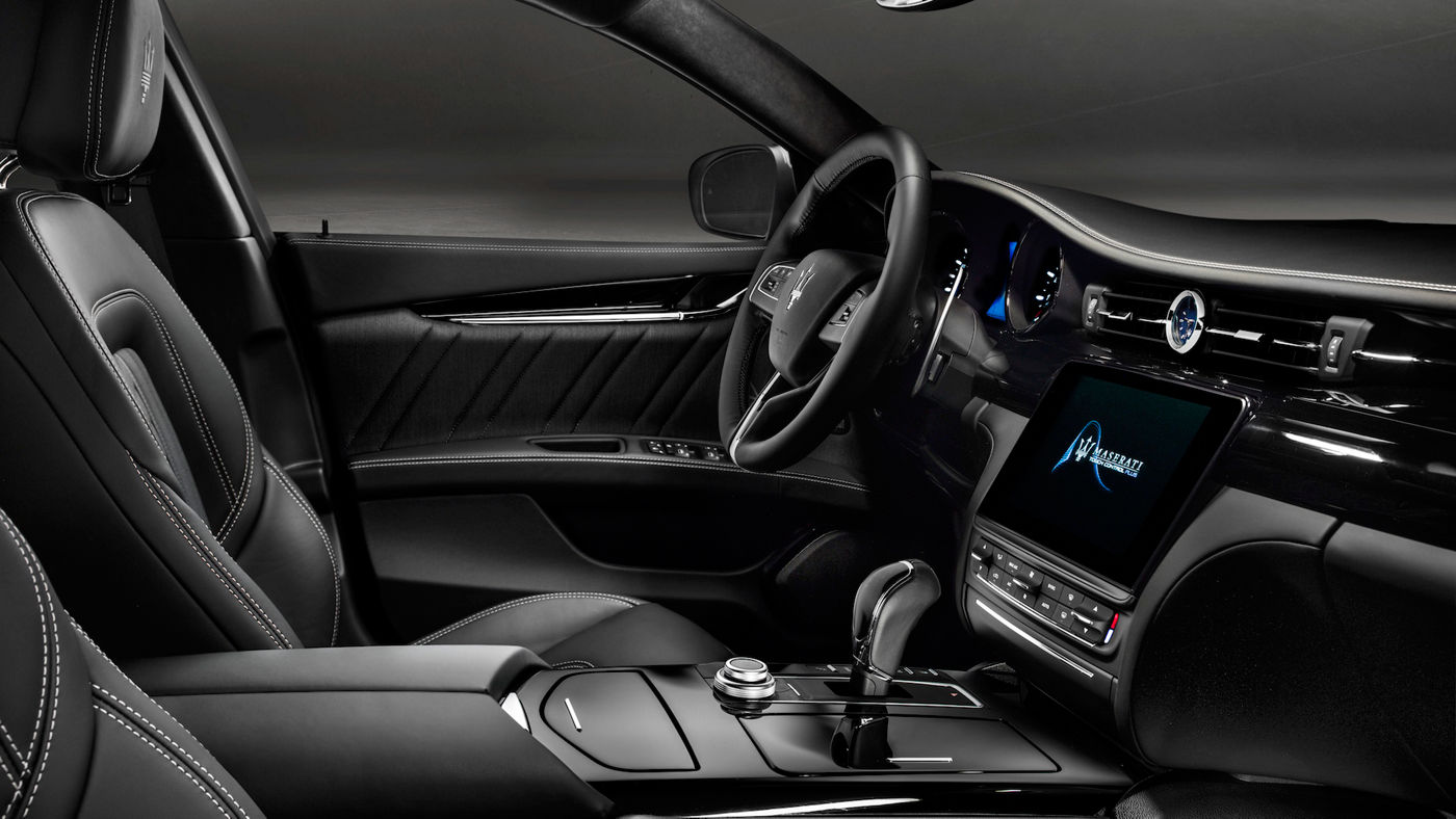 Maserati Quattroporte performance car - dashboard and interior black leather design details