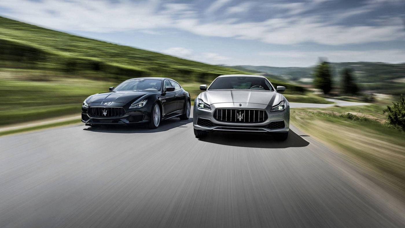 Maserati models - Quattroporte grey luxury cars in motion