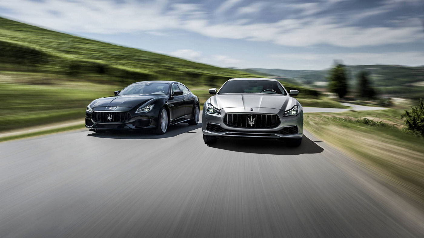 Maserati models - Quattroporte grey luxury cars in motion