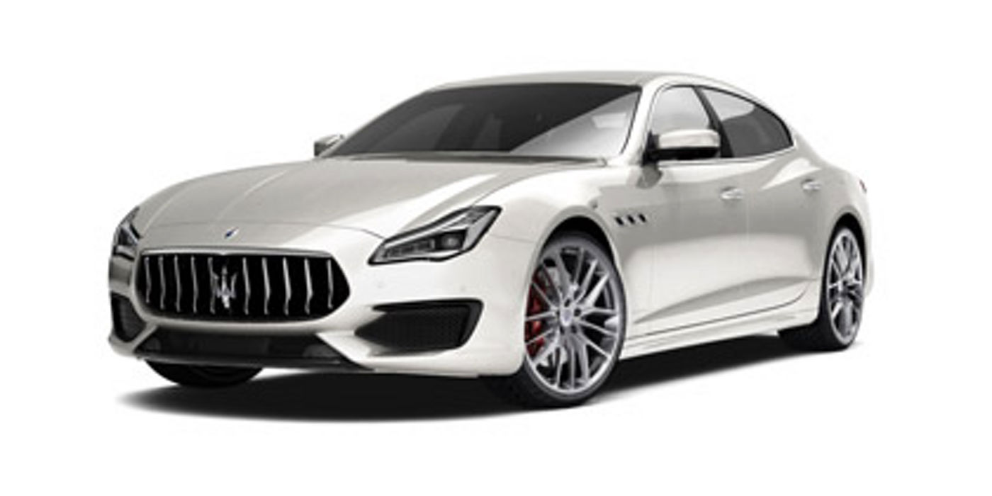 Front and side view of a white alps Maserati Quattroporte GTS GranSport