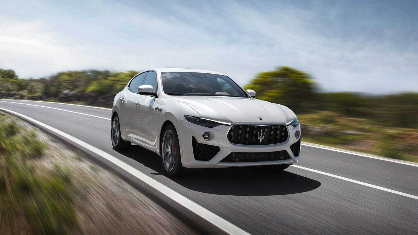 New Maserati Levante GTS - White luxury SUV on a country road