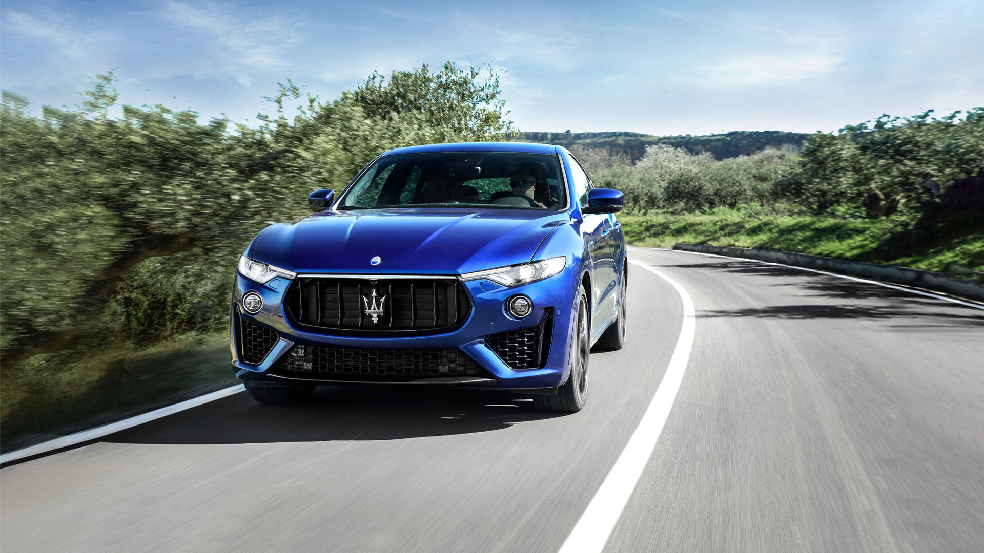 Maserati Levante - Levante GranSport front view, riding on a country road