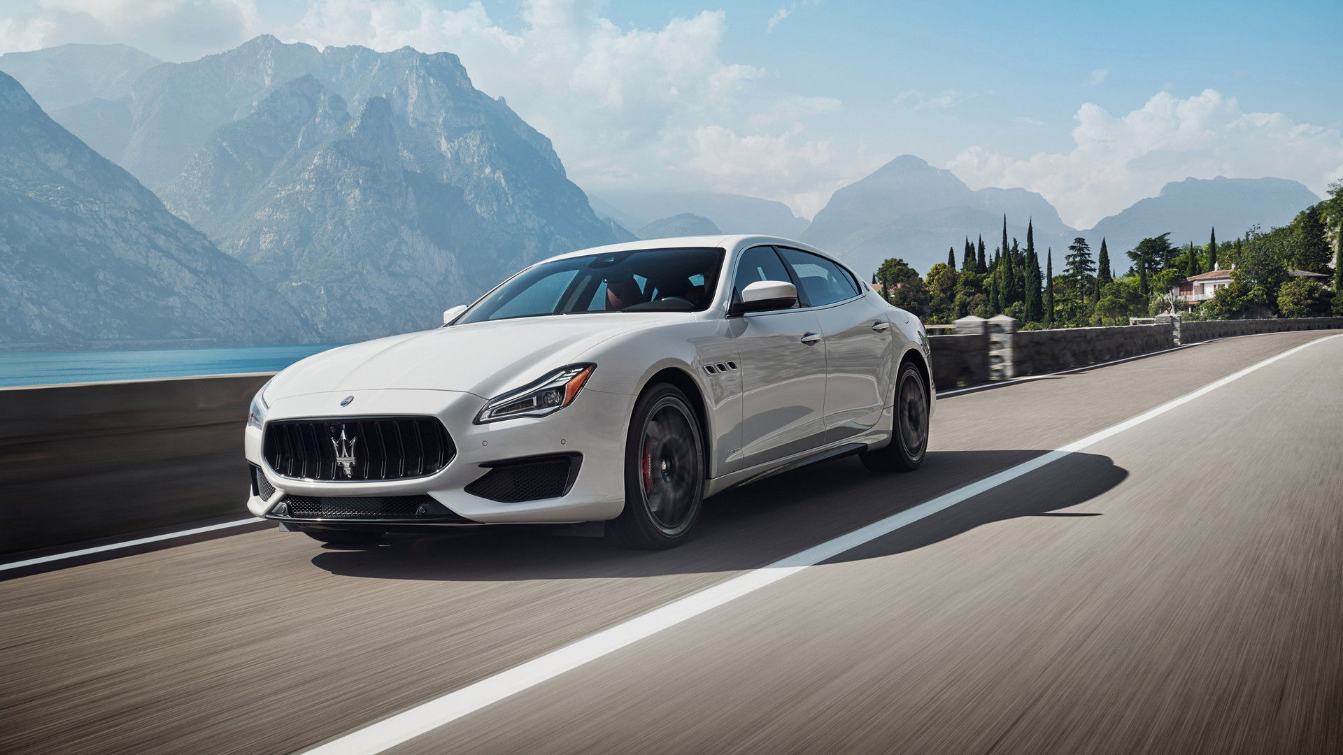 Maserati Quattroporte GTS – the luxury sedan in Bianco color on the road