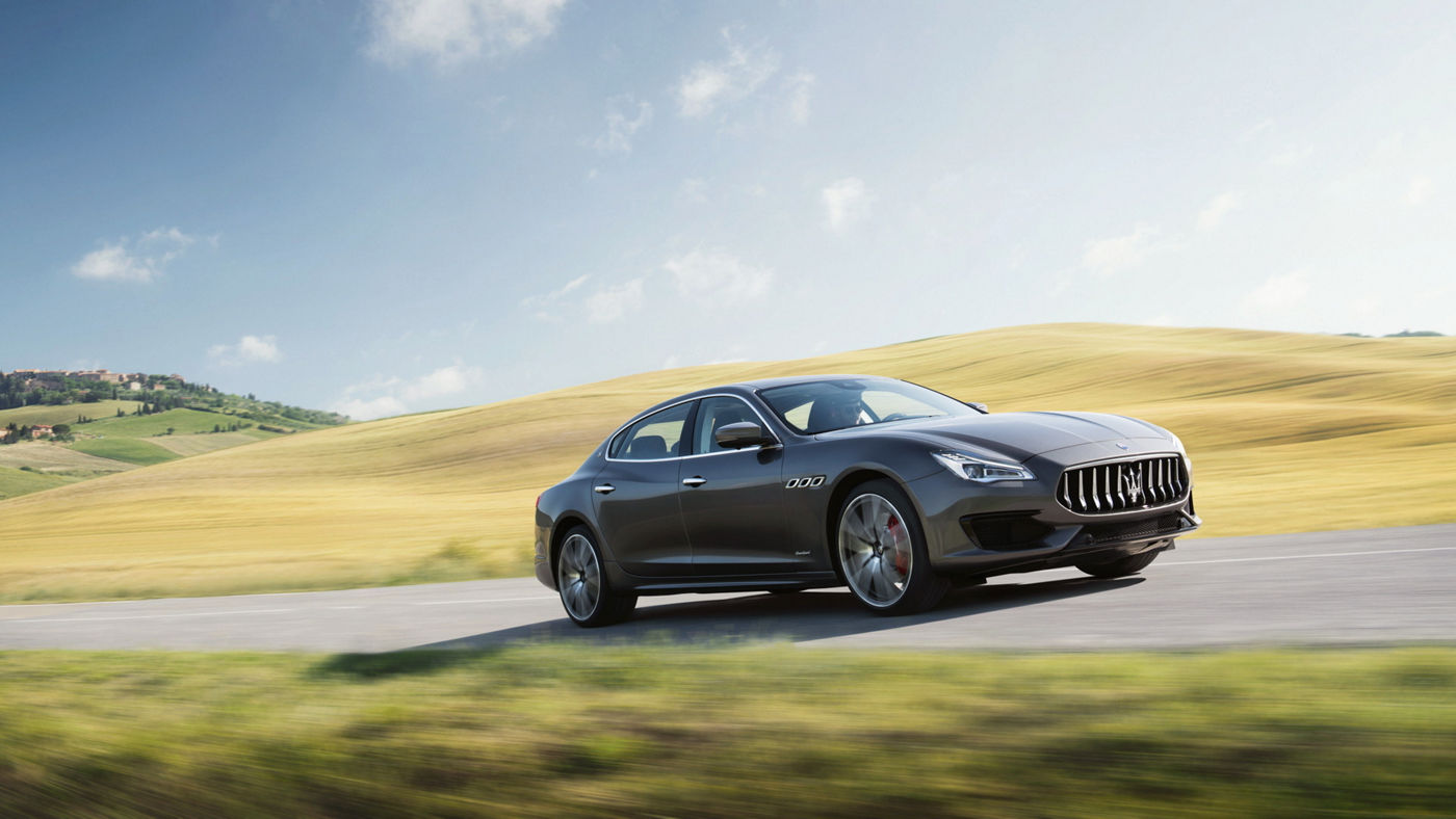 Sedan models: Maserati Quattroporte - Quattroporte side view, riding on a country road