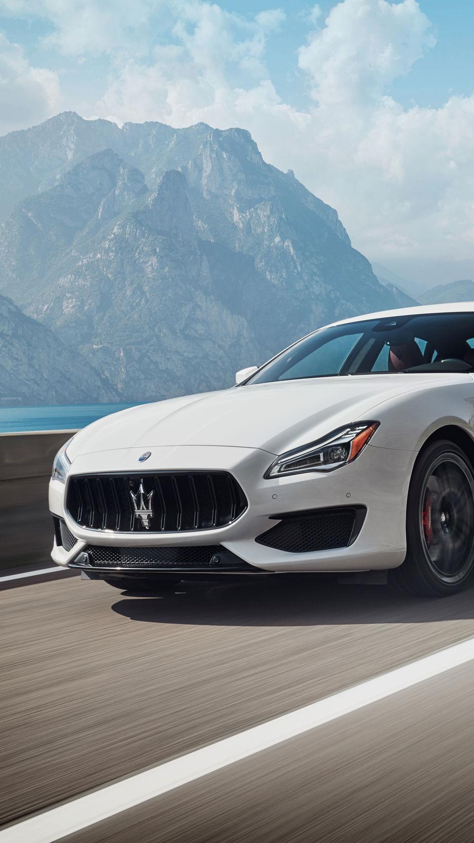 Maserati Quattroporte GTS – the luxury sedan in Bianco color on the road