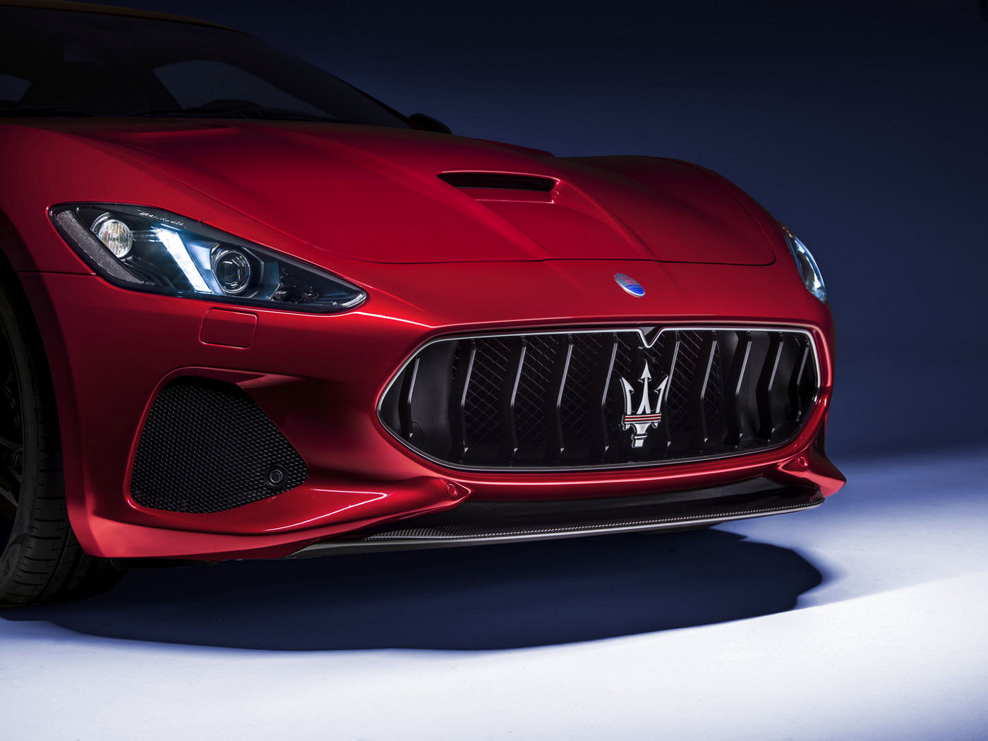 Red Maserati GranTurismo - front details with the trident emblem