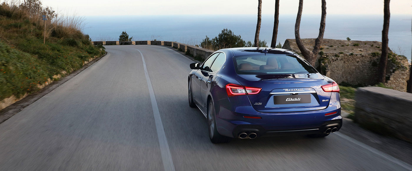 Blue Maserati Ghibli MHEV - On-road driving: Rear view