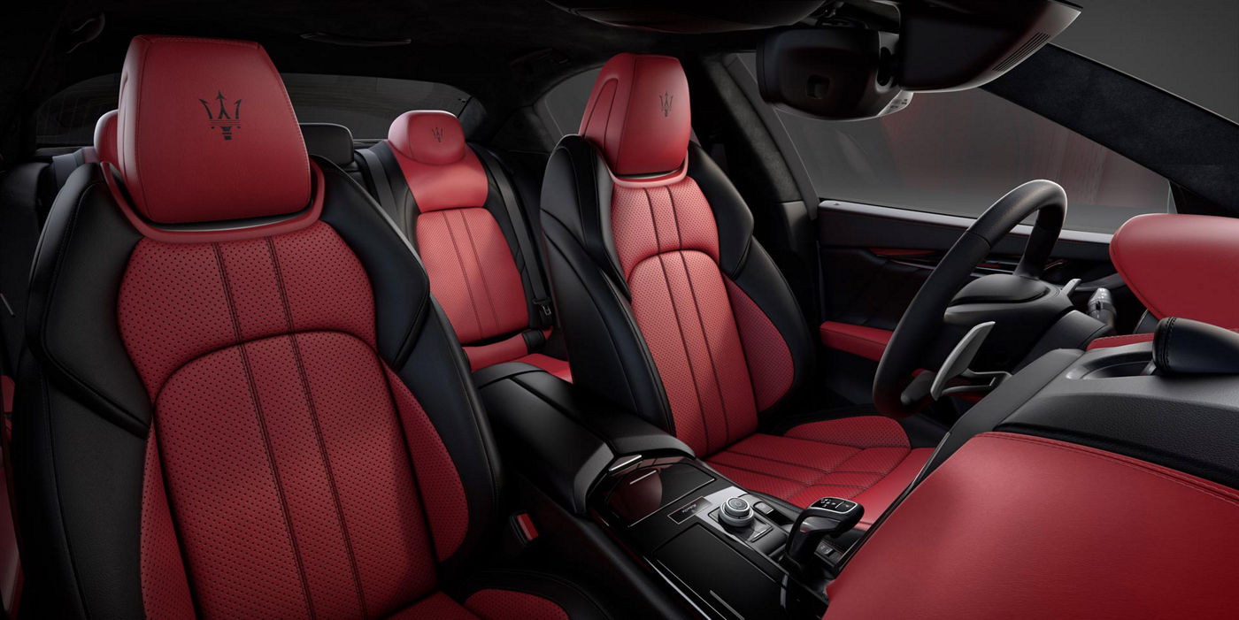 The Sedan Ghibli Ribelle interior details: black and red natural leather seats and central console