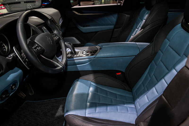 Maserati Levante GTS One of One - interior detail - denim colored dashboard, seats and door panels