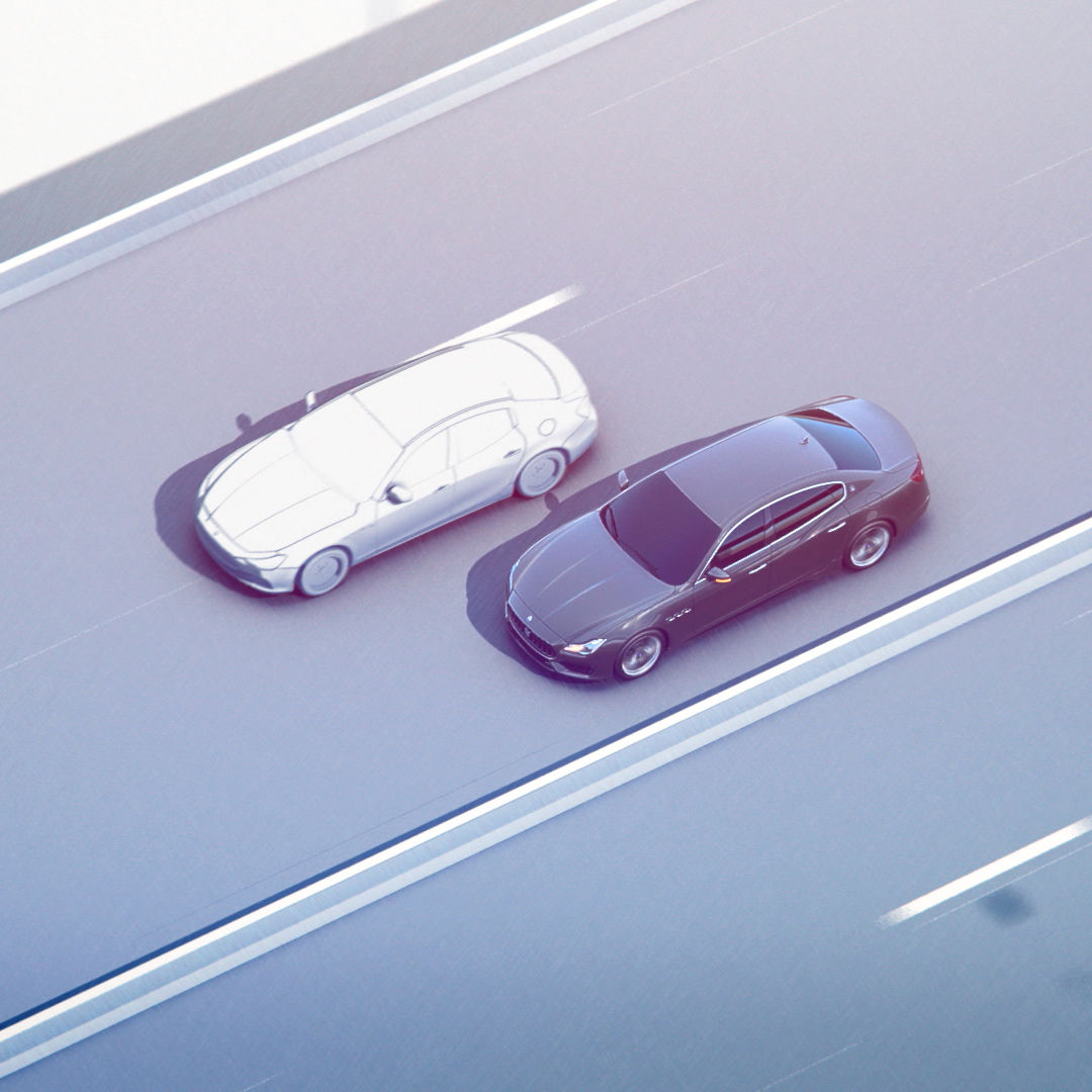 Traffic Sign Recognition - Maserati driving parallel to another car in a freeway