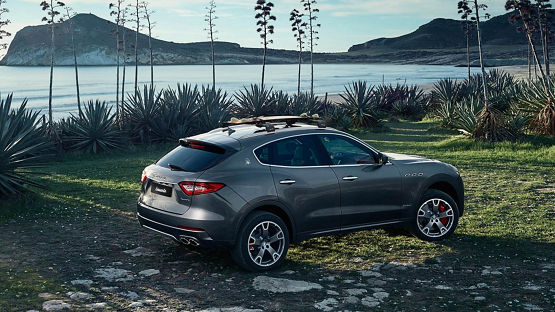 Maserati Levante on a field in front of the beach - Maserati Levante Accessories