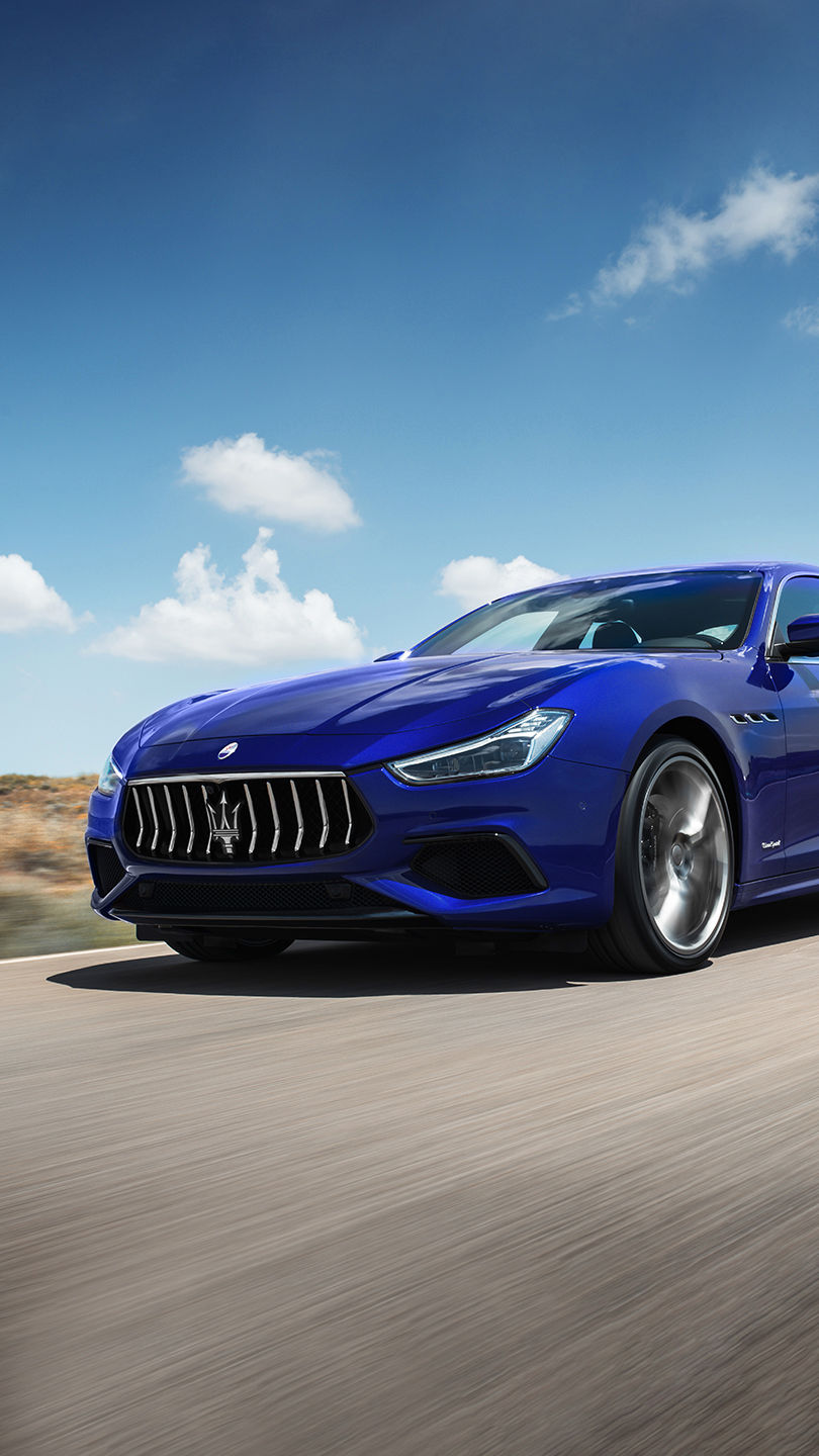 Maserati Ghibli on the road - front and side view - blurred background