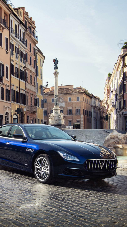 Maserati Quattroporte - Piazza di Spagna (Spanish Square) in Rome on the background