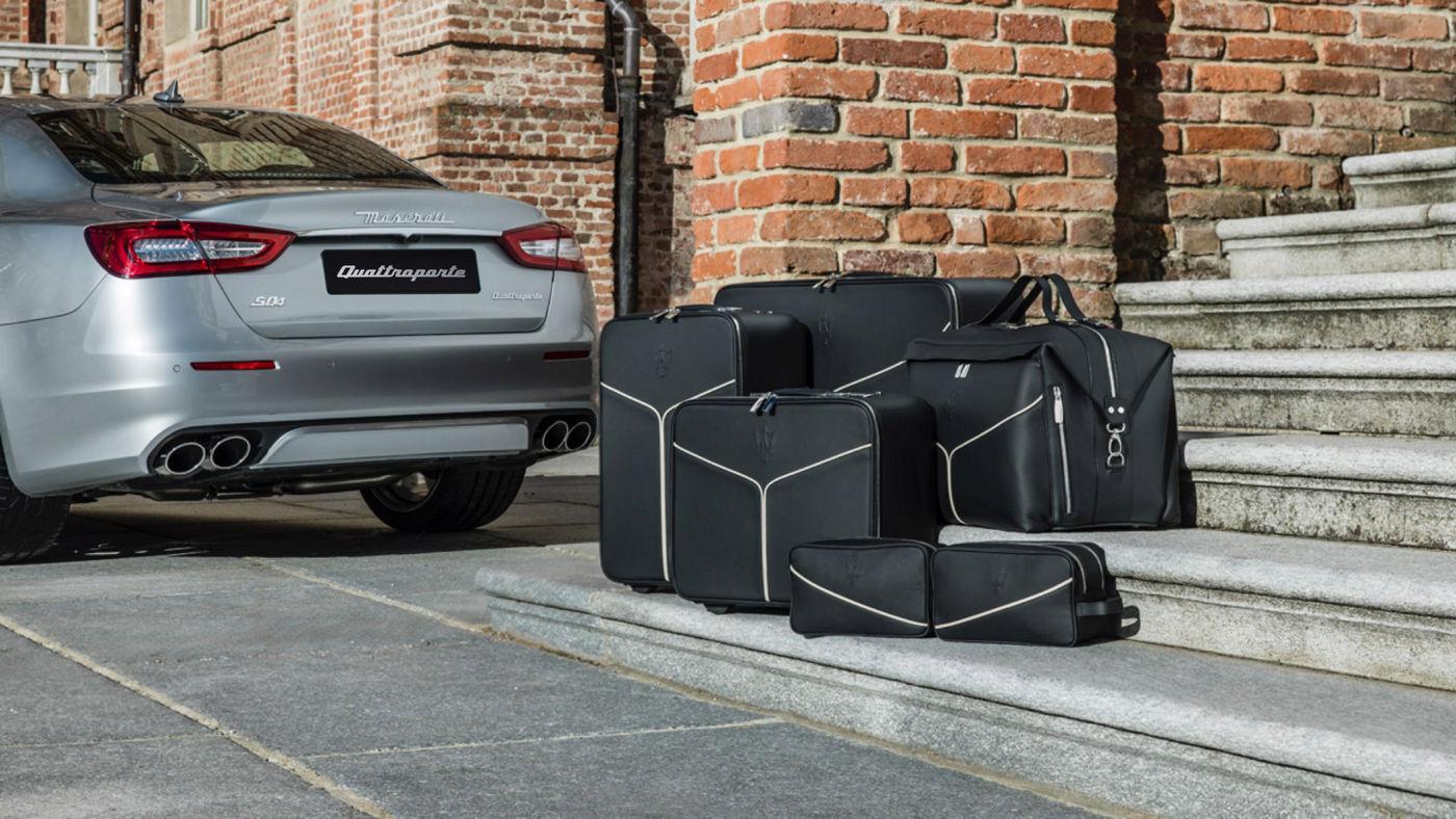 Maserati Quattroporte accessories - luggage set near the car