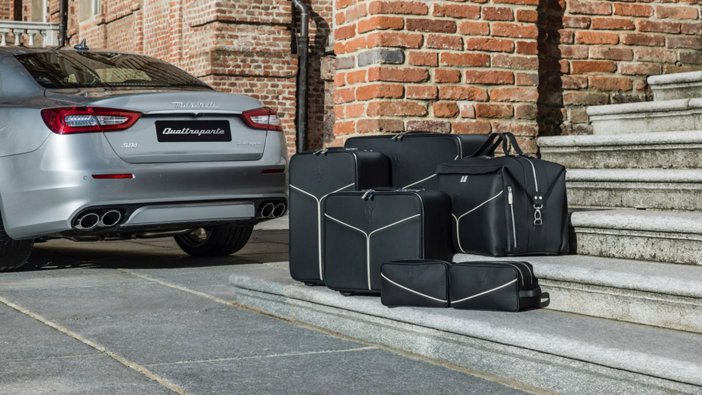 Maserati Quattroporte accessories - luggage set near the car