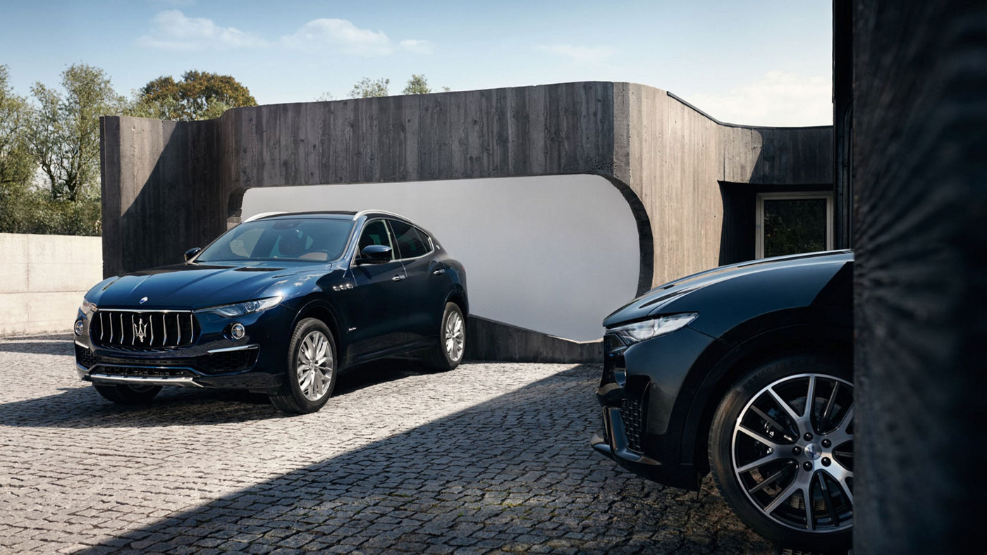 Two Maserati Levante SUVs - front and side view