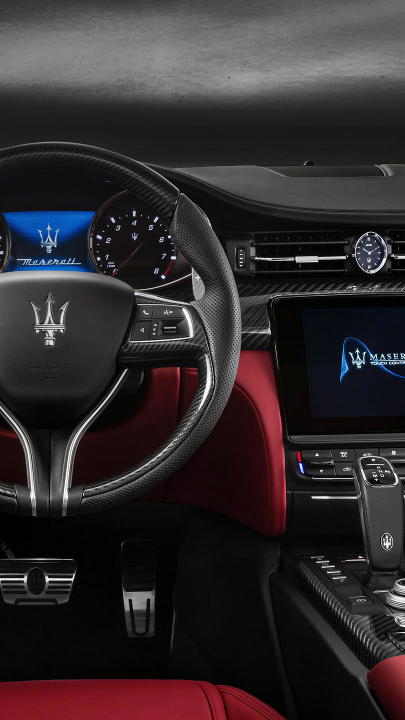 Maserati car dashboard, red and black