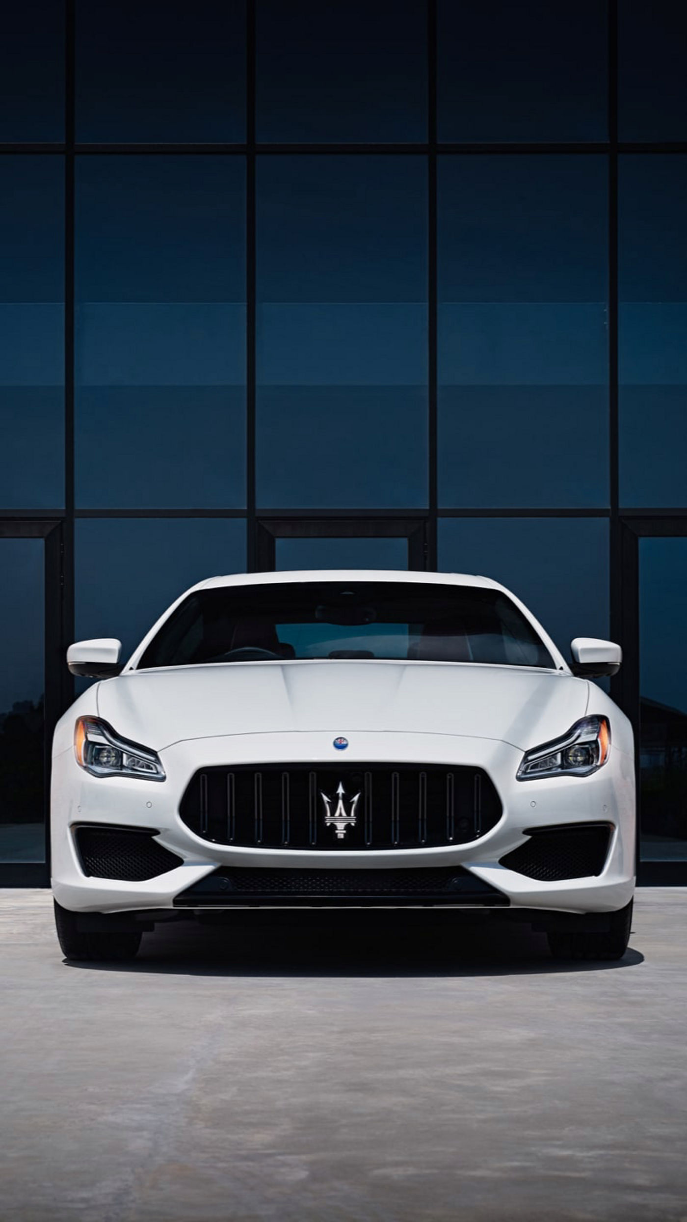 Maserati Quattroporte in front of a modern house, front view