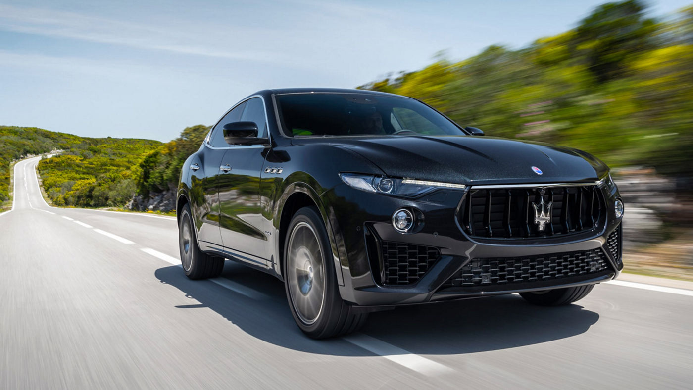 Maserati Levante SUV on the road - green hills background