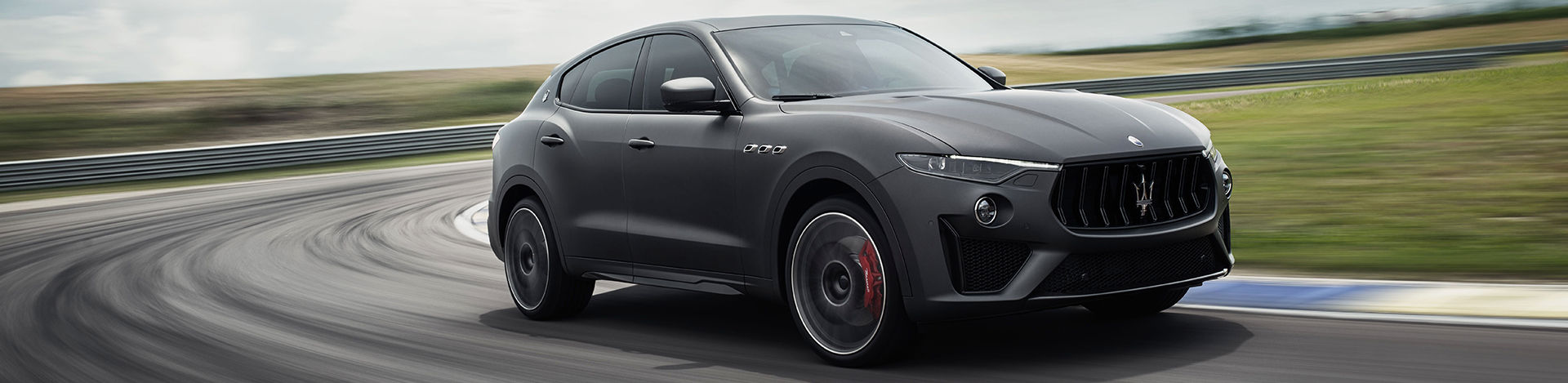 SUV Maserati Levante Trofeo side view, racing on track