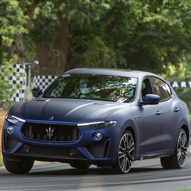 Maserati Levante Trofeo at Goodwood Festival, front view, racing on the road