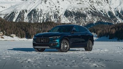 Maserati Levante Royale, front and side view, on the snow in St. Moritz