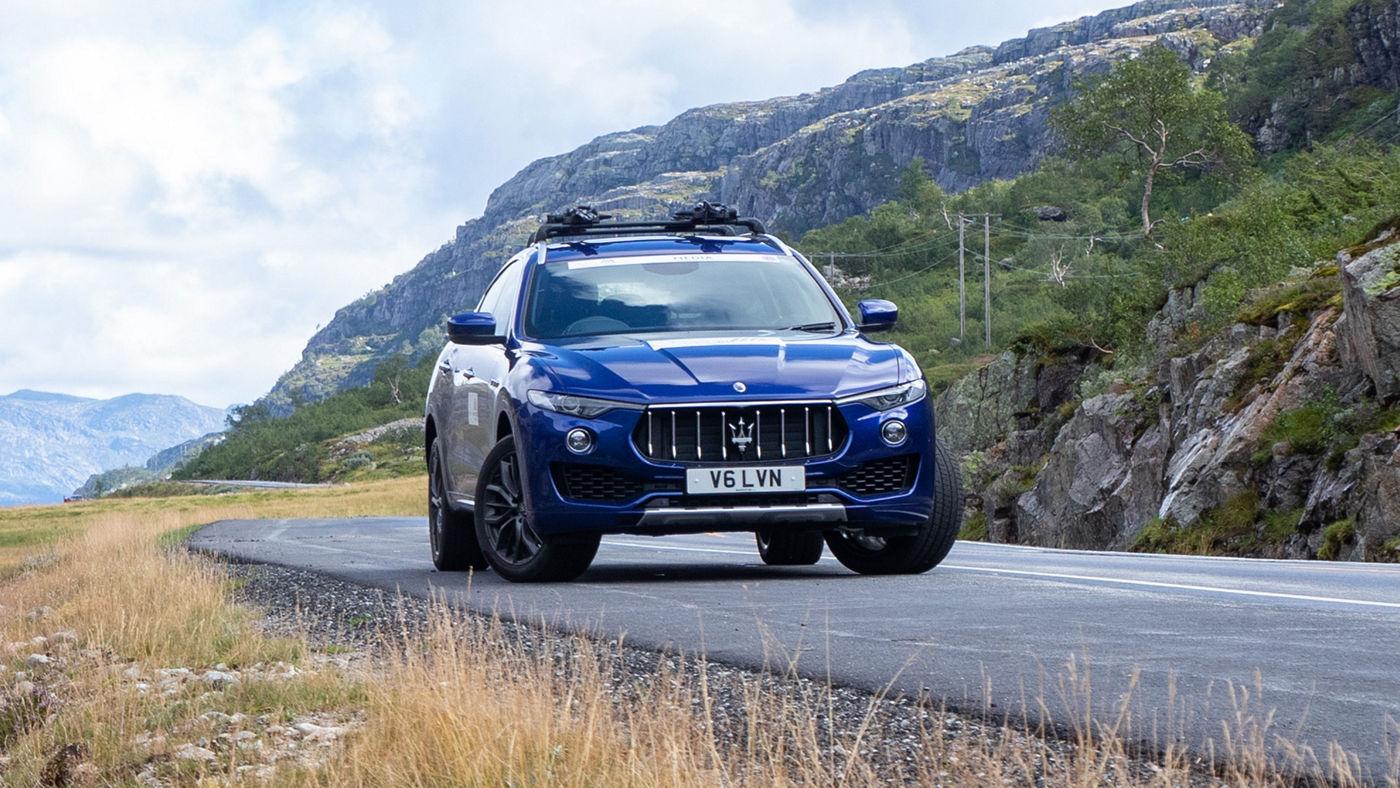 A Maserati Levante SUV runs an uphill Norwegian road