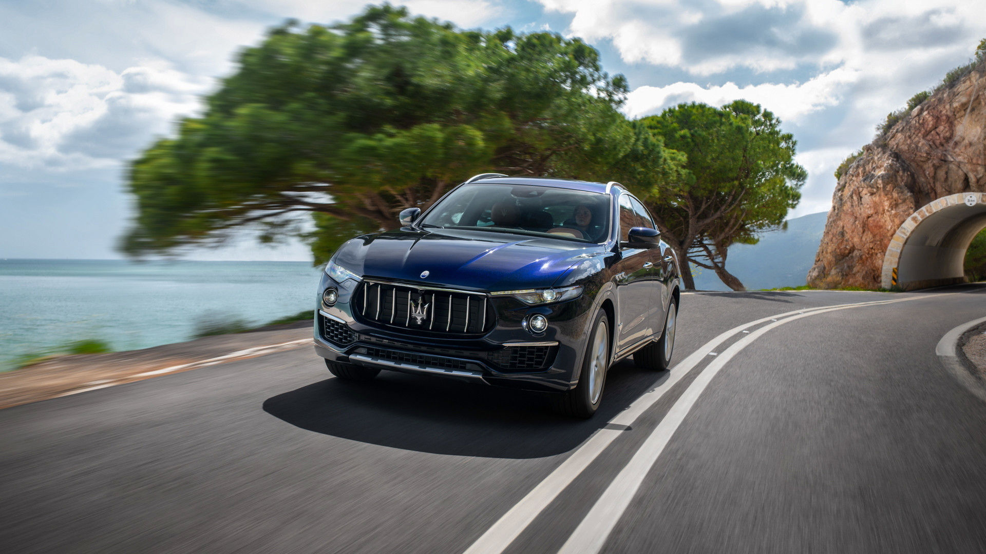 The luxury SUV Maserati Levante 2019 on the road - front view