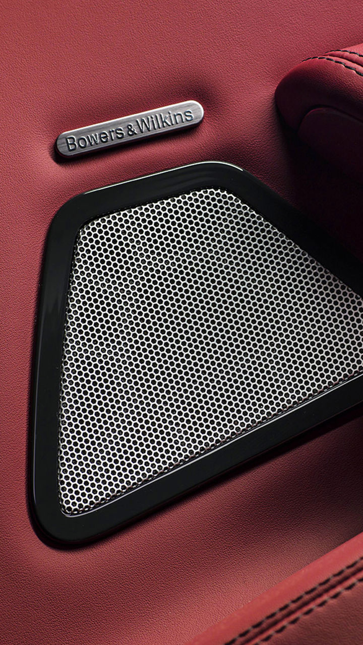 Maserati - Detail of Bowers & Wilkins speaker on red leather
