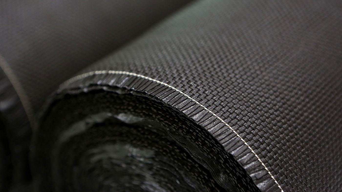 Detail of the Maserati Zegna woven PELLETESSUTA leather
