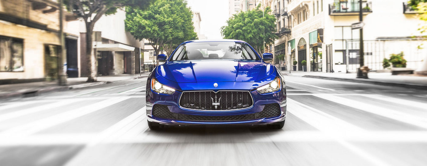 Blue Maserati Quattroporte - Sedan - Front view - On the road