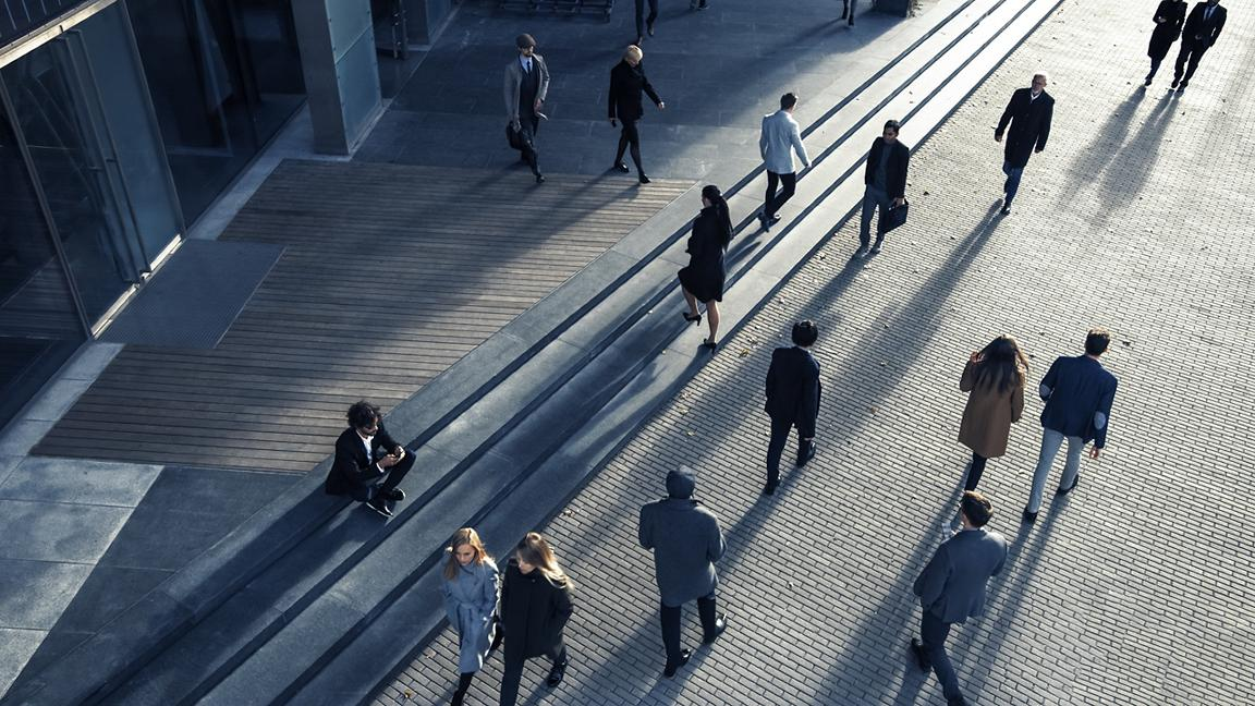 Commuters walking towards offices, viewed from above