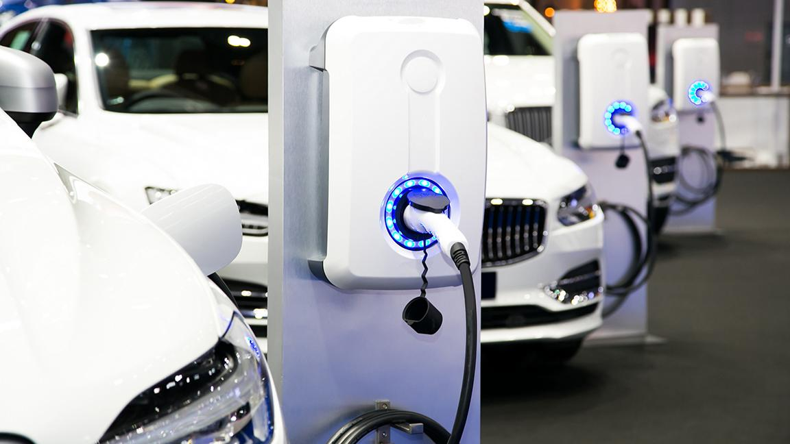 Electric cars charging at a public charging station