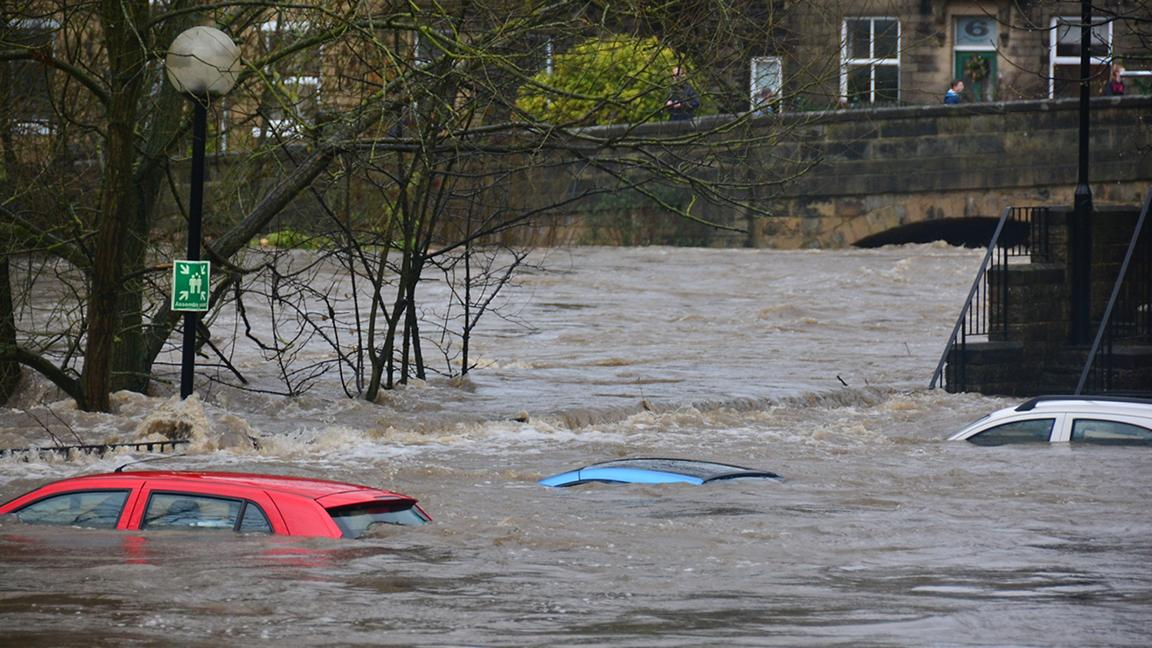 Flooded road showing submerged cars