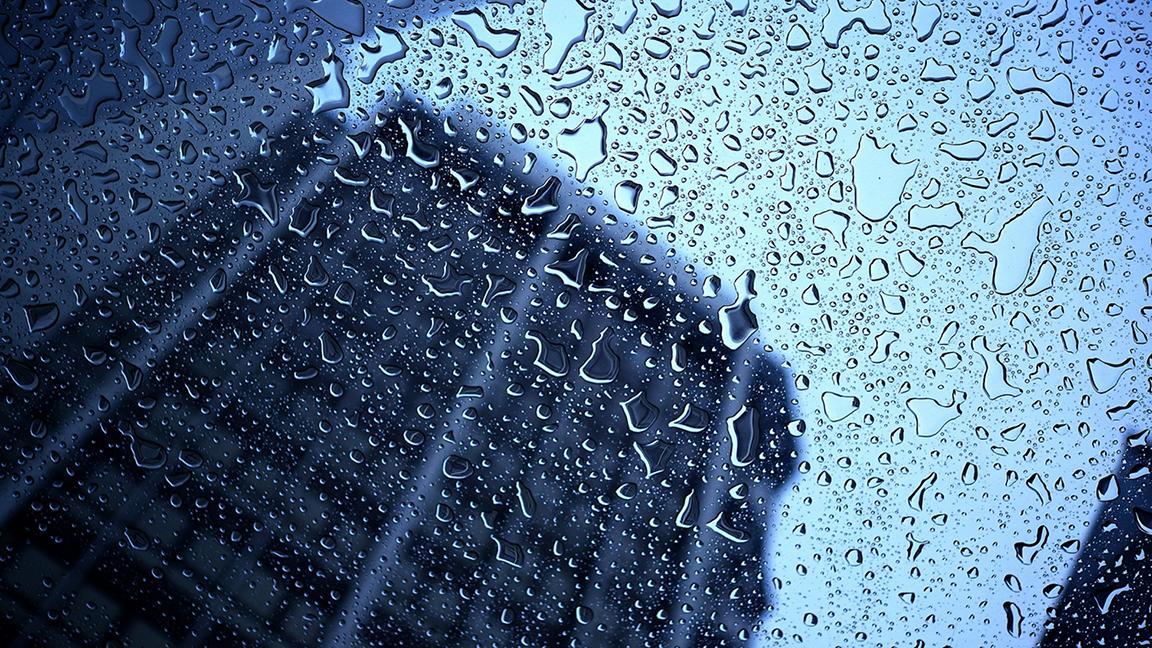 Office building seen through rainy window