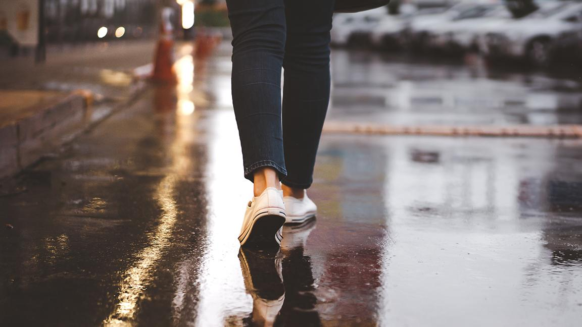 Close-up of woman's feet walking in a city street