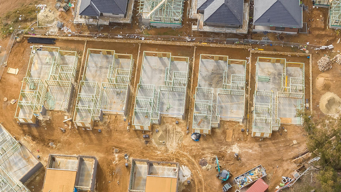 Aerial view of construction site, houses under construction