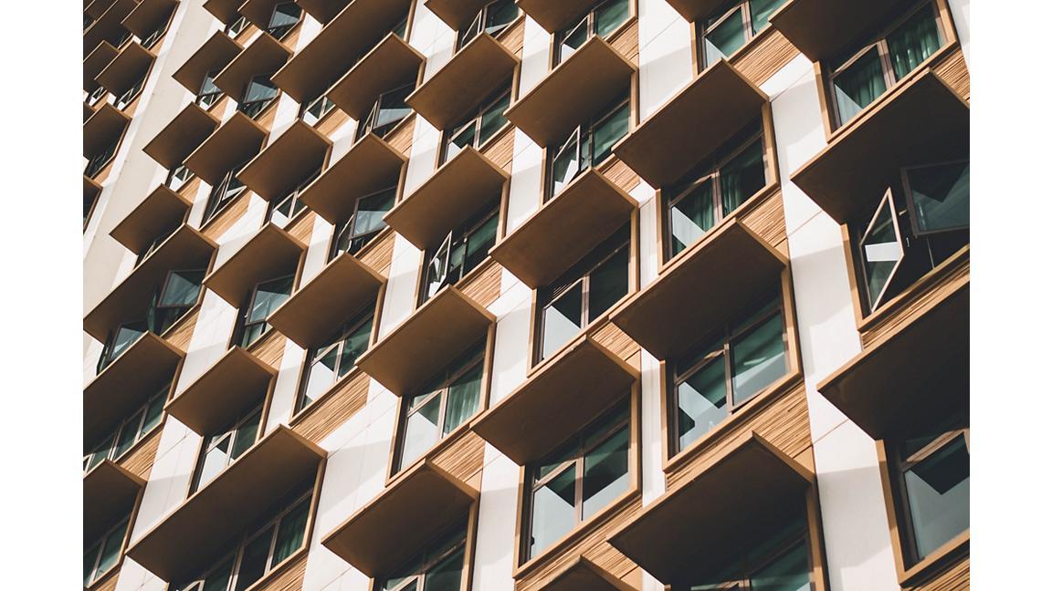 Building facade with shades over windows