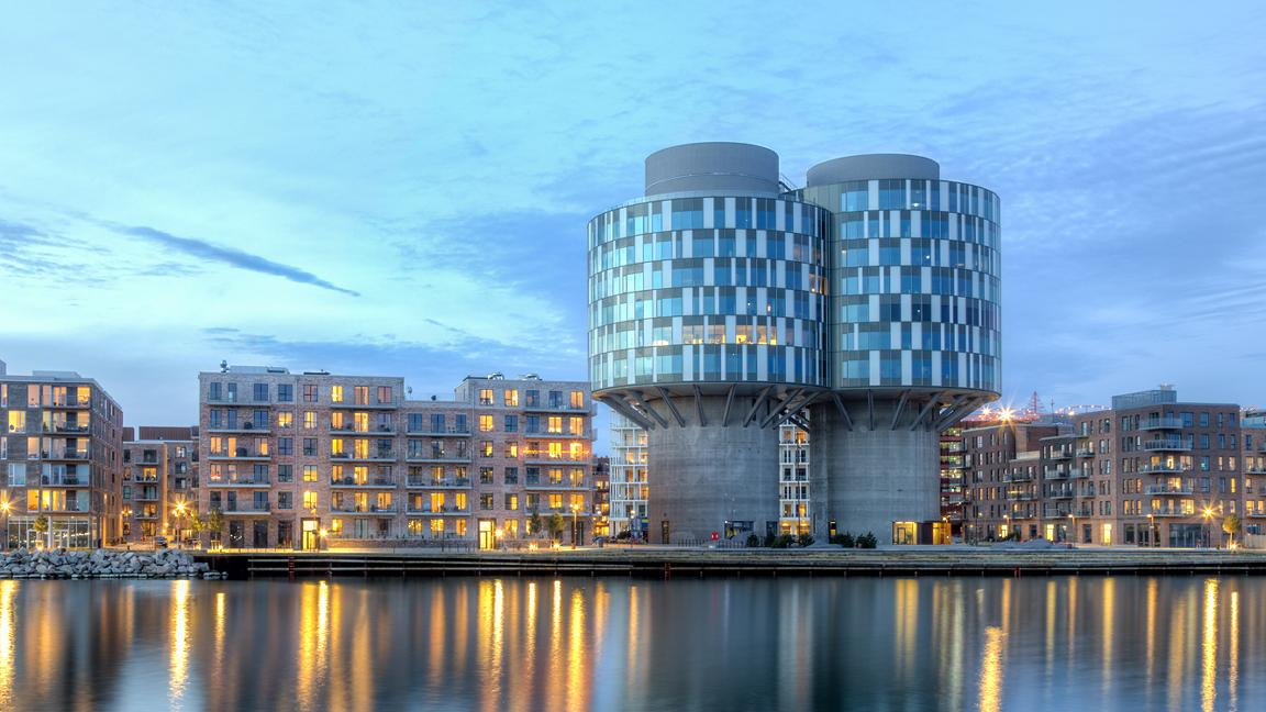 Evening view of the Portland Towers, two silos converted into office buidings in the Nordhavn district of Copenhagen, Denmark