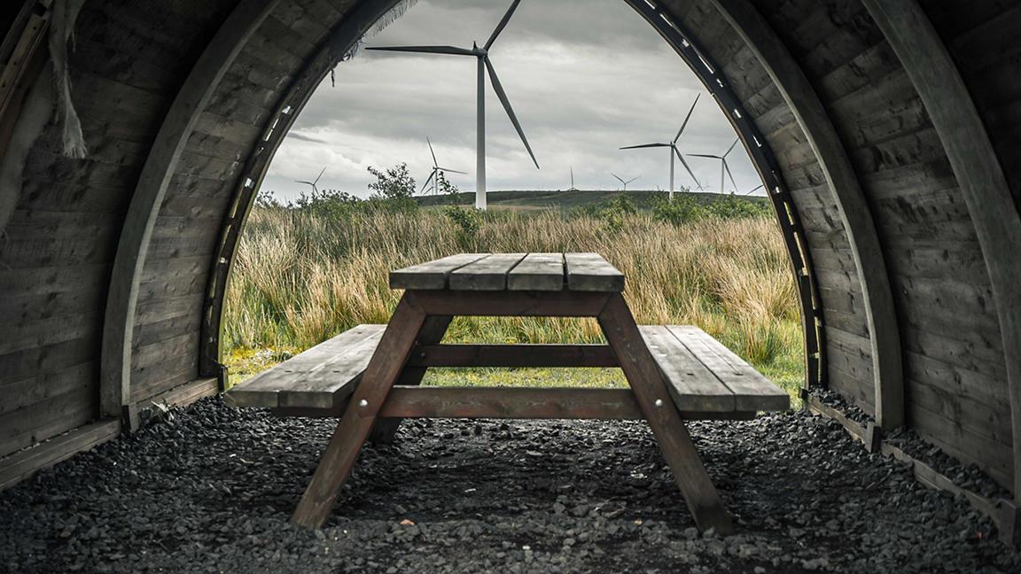 Whitelee Wind Farm on the Eaglesham moor in Scotland seen through a picnic pod