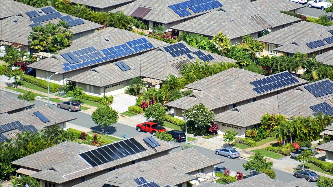 Aerial photo of houses with solar panels