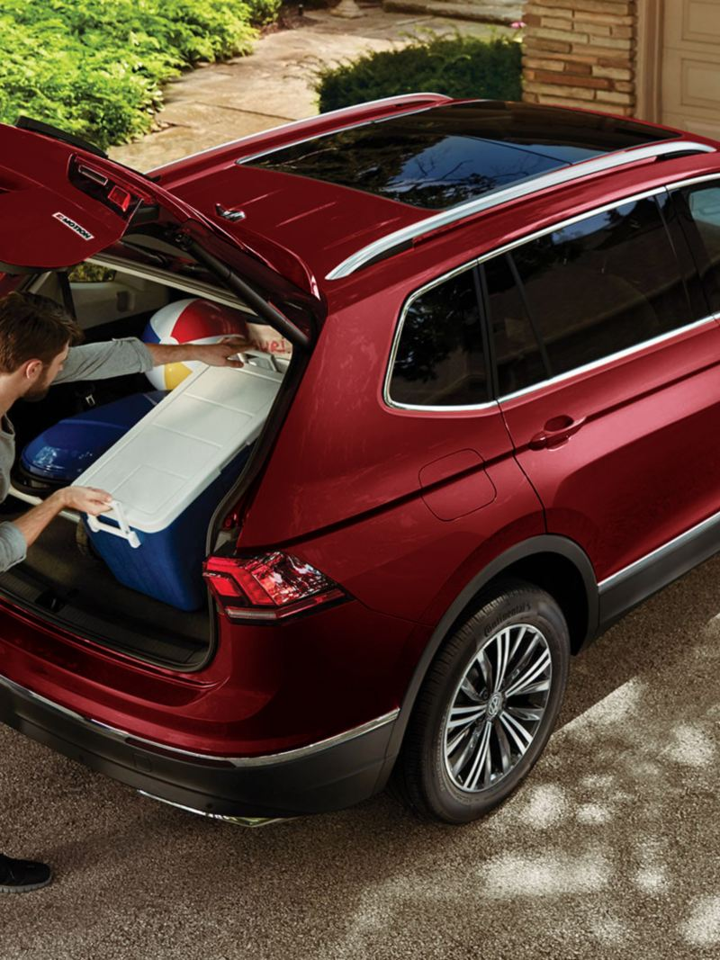 A man placing items in the Tiguan