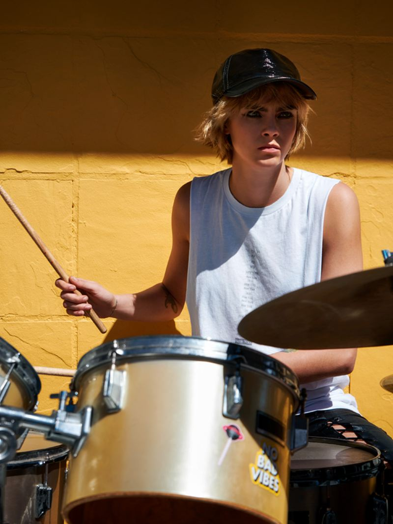 Woman playing the drums