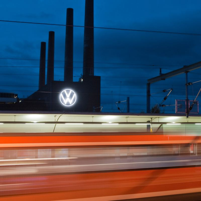 Train passing by the Volkswagen plant in Wolfsburg at night