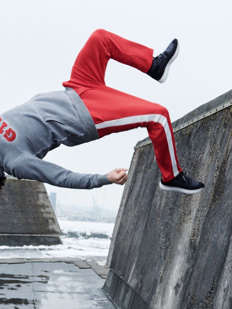 A man in clothing from the VW GTI Collection performs a backwards somersault