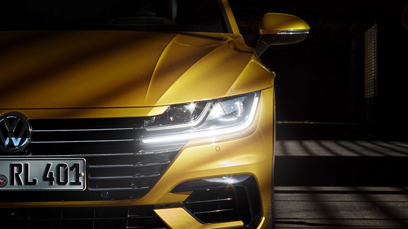 A yellow VW New Arteon with Volkswagen Genuine Bulbs