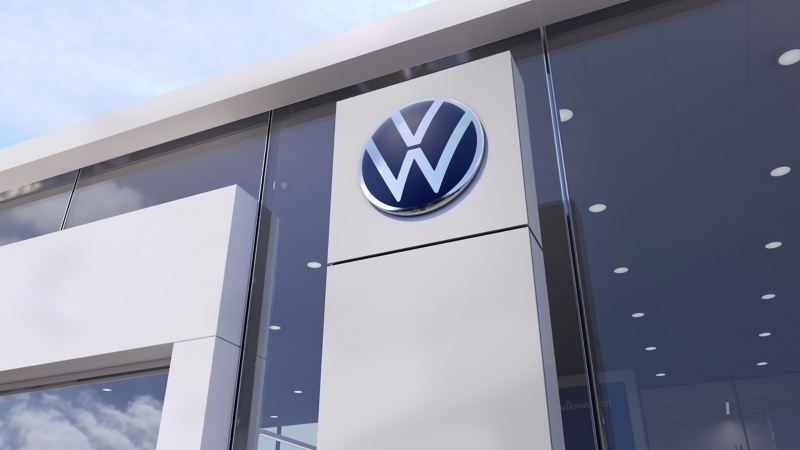 The Volkswagen logo at a Volkswagen dealership